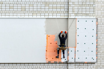 Industrial climber during winterization works.