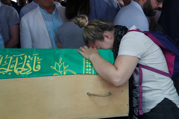 A relative mourns over the coffin of Derya Kurtulus, one of the victims of the train accident, during her funeral ceremony in Corlu