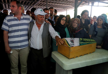People attend funeral ceremony of Beren Kurtulus, a five-month old victim of the train accident, in Corlu