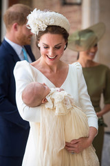 Britain's Catherine, the Duchess of Cambridge, carries Prince Louis as they arrive for his christening service at the Chapel Royal, St James's Palace, London