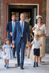 Britain's Princess Charlotte and Prince George hold the hands of their father, the Duke of Cambridge, as they arrive for the christening of their brother, Prince Louis, who is being carried by the Duchess of Cambridge, at the Chapel Royal