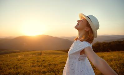 happy girl enjoying nature at sunset