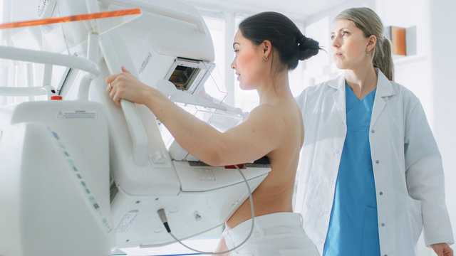 In the Hospital, Portrait Shot of Topless Female Patient Undergoing Mammogram Screening Procedure. Healthy Young Female Does Cancer Preventive Mammography Scan. Modern Hospital.