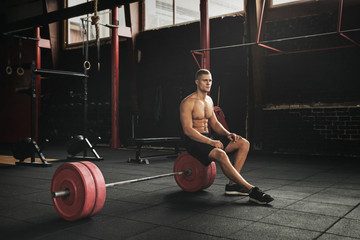 Muscular young man resting between sets
