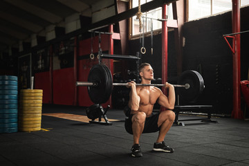 Muscular man during his weightlifting workout in the gym