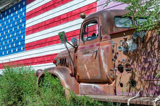 Old truck and american flag, symbol of US Route 66