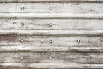 rusting silver metal panel background