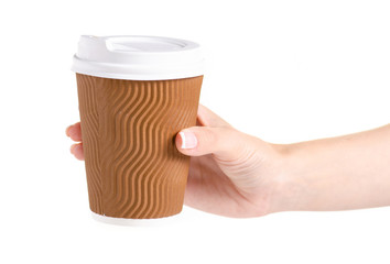 Cup of coffee with a lid in a hand on a white background isolation