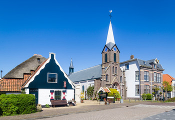 Village Oudeschild with Martinus church and trraditional gable  houses on the Wadden island Texel in the Netherlands Wall mural