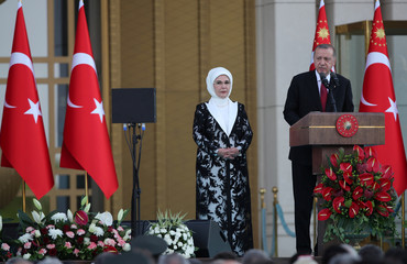 Turkish President Tayyip Erdogan, accompanied by his wife Emine Erdogan, makes a speech during a ceremony at the Presidential Palace in Ankara