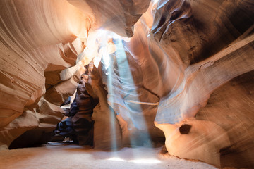 Upper Antelope Canyon with light rays filtering through sand dust