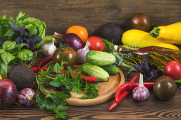 Many delicious juicy colorful summer vegetables and herbs