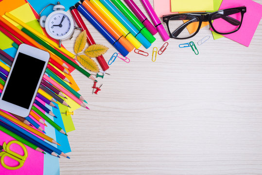 Set of school stationery on the desk top view.