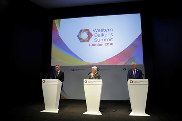 Germany's Minister of State for Europe Michael Roth speaks as British Minister of State for Europe and the Americas Alan Duncan and Polish Minister of Foreign Affairs Jacek Czaputowicz listen during the Western Balkans Summit in London