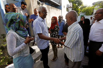 Ibrahim Mohamed Solih, Maldivian opposition candidate, talks with people as part of his campaign for the upcoming presidential election in September 2018, in the island of Villingili