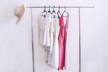 Set of fashionable clothes on a hanger for the summer