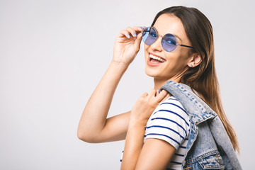 Fashion concept! Young happy beautiful fashion woman with sunglasses on a white background. Style concept.