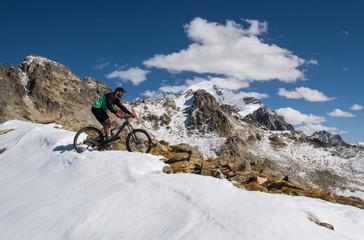 Cyclist riding on a mountain bike in the snow