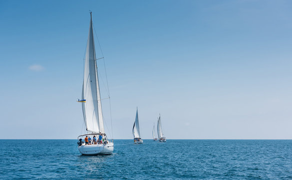 Fleet of sailing boats during race