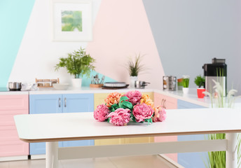 Flowers on table in colorful kitchen
