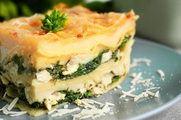 Piece of tasty spinach lasagna on plate, closeup