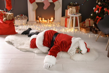 Authentic Santa Claus lying on floor indoors