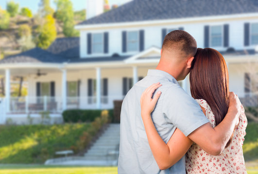 Affectionate Military Couple Looking at Beautiful New House