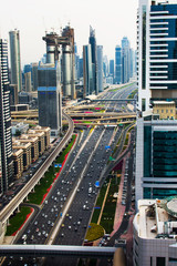 Dubai, United Arab Emirates - April 3, 2018: Busy sheik Zayed road surrounded by modern skyscrapers of downtown Dubai