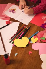 Girl drawing on valentine card