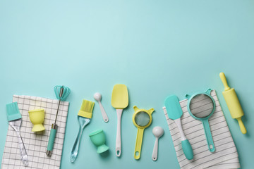 Time to cook. Pastel yellow, blue cooking utensils on turquoise background. Food ingredients. Cooking cakes and baking bread concept. Copy space. Top view. Flat lay