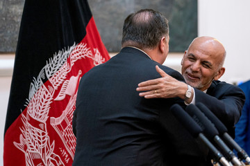 Afghan President Ashraf Ghani and Secretary of State Mike Pompeo hug following a news conference at the Presidential Palace in Kabul
