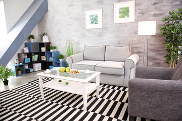 Modern living room design with big striped carpet