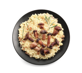 Plate with tasty risotto and mushrooms on white background