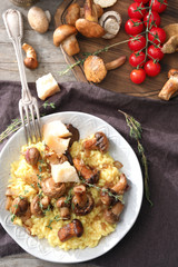 Plate with tasty risotto and mushrooms on table