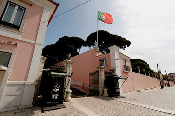Presidential palace guards stay at the entrance of Belem presidential palace in Lisbon