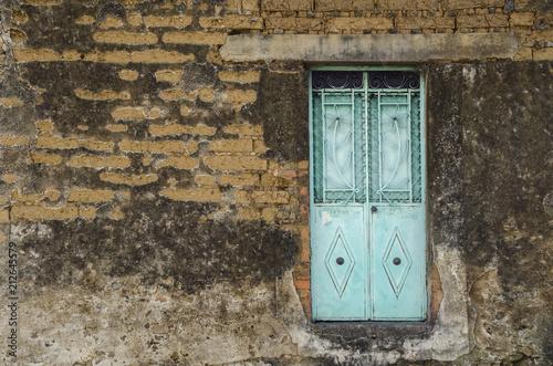 Cyan Door. Floating Door In A Run Down Wall In Mexico