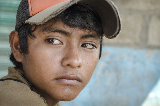Latin American teen Great glance portrait from a young boy in the southern border of Mexico