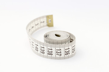 Tape for measuring isolated on white background. Used for sewing and during diet.