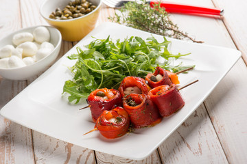 capsicum stuffed with mozzarella and capers with arugula salad