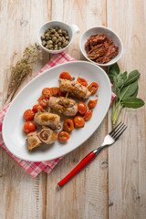 turkey rolled up with dried tomato capers sage and oregano