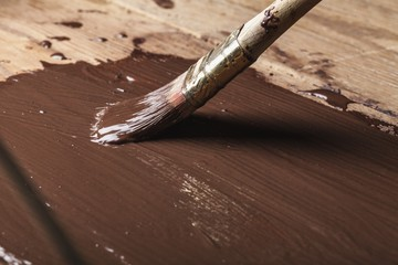 Painting a wood frame with chocolate color.