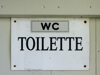 wc toilet - black lettering on a white background