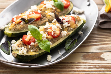 Zucchini boat filled with ground beef, mushroom, tomato sauce and parmesan cheese.