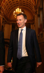 Britain's new Secretary of State for Foreign and Commonwealth Affairs Jeremy Hunt, accompanied by senior civil servant Simon McDonald, arrives at the Foreign Office in central London