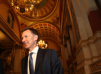Britain's new Secretary of State for Foreign and Commonwealth Affairs Jeremy Hunt arrives at the Foreign Office in central London