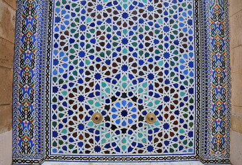 colorful wall mosaic at facade of mosque in Rabat, Morocco