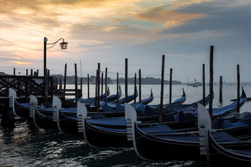 Moored goldolas in the early morning , Venice , Italy
