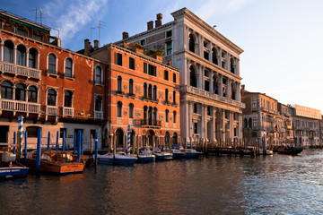 Boats, gondolas and colorful architecture viewed from boat in the Grand canal Italy