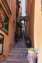 Colorfull and ornate alley in Toarmina , Italy