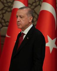Turkish President Tayyip Erdogan arrives a presser at the Presidential Palace in Ankara